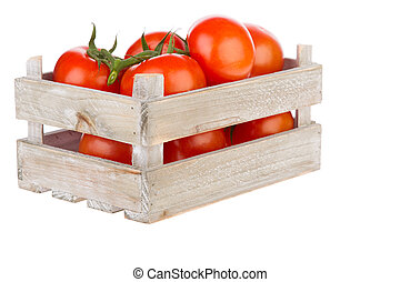 Fresh tomatoes in a wooden crate