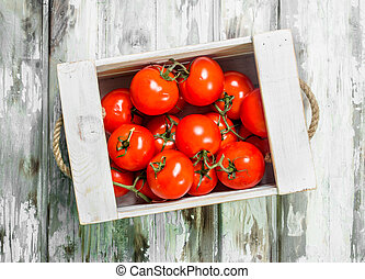 Fresh tomatoes in the box.