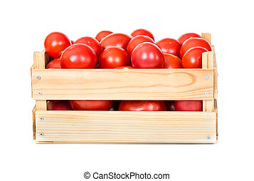 Fresh tomatoes in wooden box