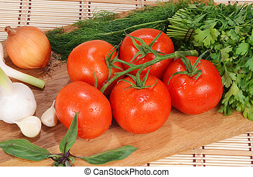 fresh tomatoes on a branch
