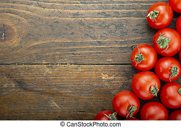 Fresh tomatoes on a wooden table. Harvesting tomatoes. Top view.