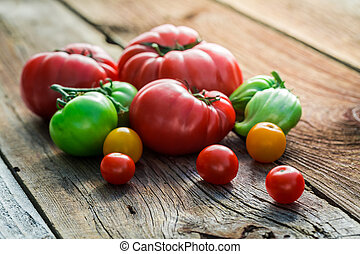 Fresh tomatoes on old wooden table