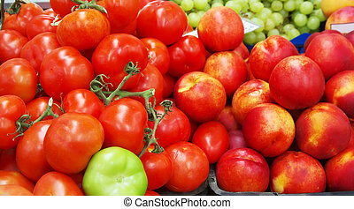 Fresh tomatoes & peaches in market