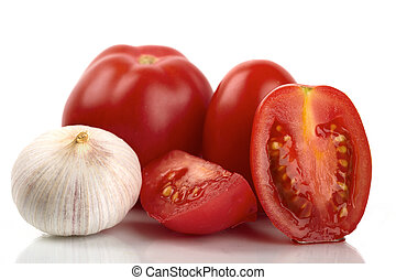 Fresh tomatoes with garlic onion on a white background