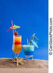 Fresh tropical cocktail on sunny beach