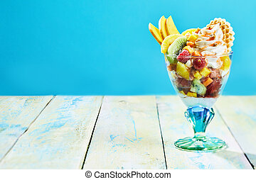 Fresh tropical fruit salad with whipped cream