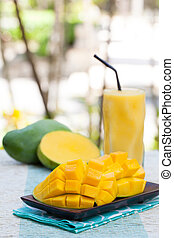 Fresh tropical fruit smoothie mango juice and fresh mango Copy space