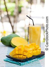 Fresh tropical fruit smoothie mango juice and fresh mango Copy space