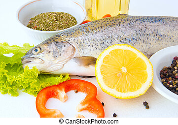 Fresh trout with a lemon, seasonings and olive oil