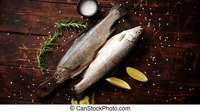 Fresh trout with lemon on board - From above view of fresh...