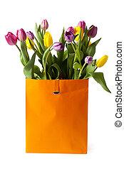 fresh tulips in paper bag