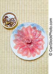 Fresh tuna in white dish with sauce