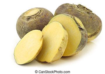 fresh turnip(brassica rapa rapa) and a cut oneon a white ...
