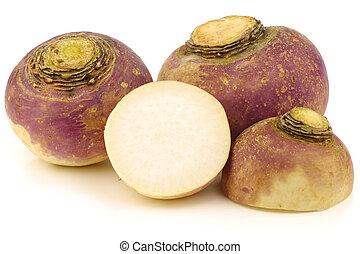 fresh turnips and a cut one