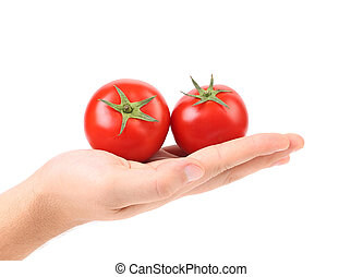 Fresh two tomatoes on hand.