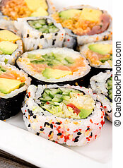 fresh various raw fish sushi plate closeup