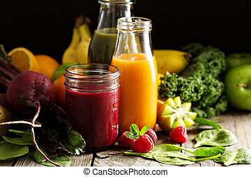 Fresh vegetable and fruit juices with beets, berries and greens
