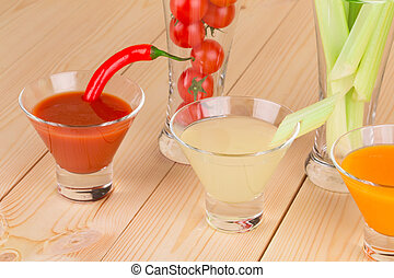 Fresh vegetable juices in glasses.