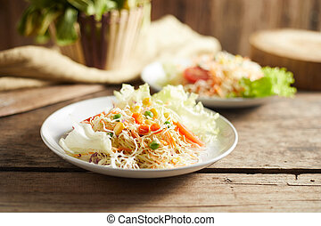 Fresh vegetable mixed salad on plate.