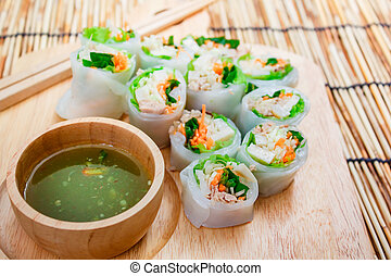 Fresh vegetable noodle spring roll with spicy sauce. - Fresh...