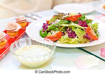 Fresh vegetable salad and cake