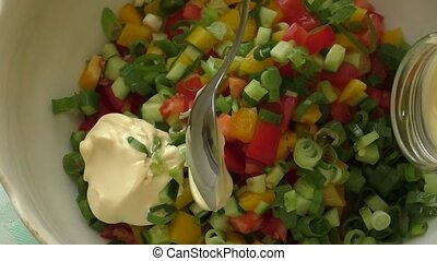 Fresh vegetable salad dressed with mayonnaise