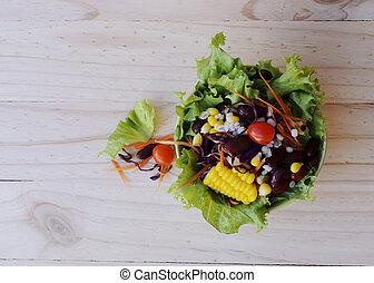 Fresh vegetable salad for health food on wooden backgrounds above