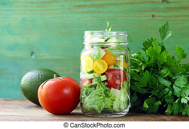 Fresh vegetable salad in a glass jar