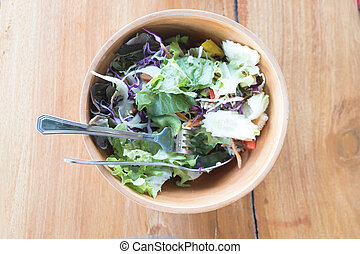 Fresh vegetable salad in a wooden bowl