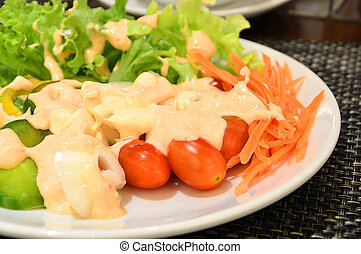 Fresh vegetable salad in white plate
