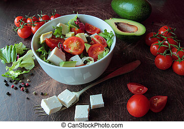 Fresh vegetable salad on a wooden table