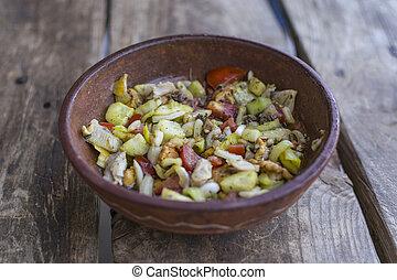 Fresh, vegetable salad on wooden table