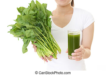 Fresh vegetables and a glass of vegetable juice