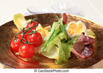 Fresh vegetables and boiled eggs on plate
