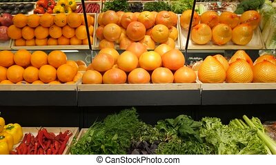 Fresh vegetables and fruit on shelf in supermarket - Various...