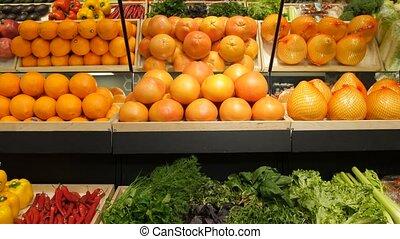 Fresh vegetables and fruit on shelf in supermarket