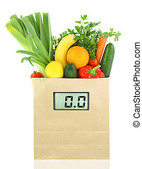 Fresh vegetables and fruits in a paper grocery bag with digital diet scale