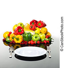 Fresh vegetables and fruits with empty plate