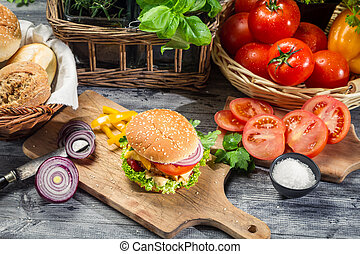 Fresh vegetables and herbs as ingredients for homemade hamburger