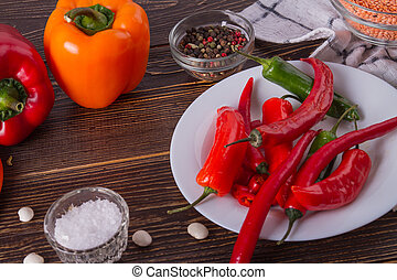 Fresh vegetables and spices on wooden table.