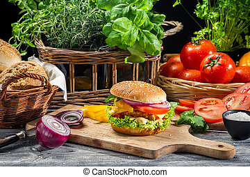 Fresh vegetables as ingredients for homemade hamburger