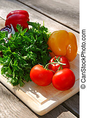 Fresh vegetables - Assorted fresh vegetables on cutting ...