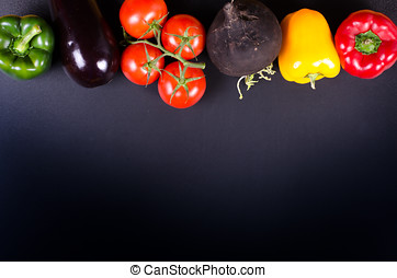 Fresh vegetables, autumn background. Healthy eating frame.