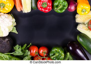 Fresh vegetables, autumn background. Healthy eating frame.