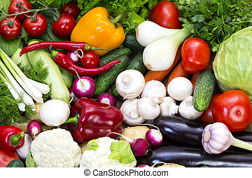 Fresh vegetables background close-up of tomatoes, cucumbers,...