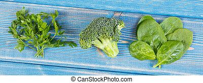 Fresh vegetables containing calcium and dietary fiber,...