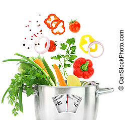 Fresh vegetables falling into a casserole pot with weight scale
