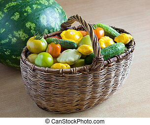 Fresh vegetables from the garden in a wicker basket.