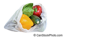 fresh vegetables in a reusable bag isolated on white background with copy space at the right