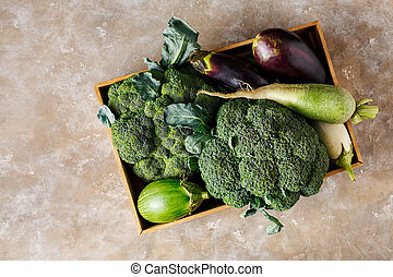 Fresh vegetables in a wooden box.